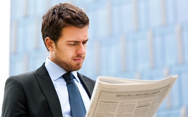 A man reading a newspaper, illustrative (Man with newspaper via Shutterstock)