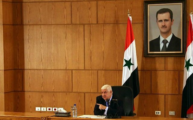 Syria's Foreign Minister Walid Moallem speaks during a press conference on August 25, 2014 in Damascus. (photo credit: AFP/STR)