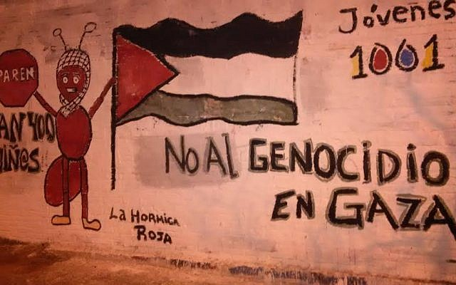 "This mural in the Uruguayan coastal city of Punta del Este was removed. In Spanish it says ""STOP: No to the genocide in Gaza"" and ""400 children,"" and is signed ""Red Ant."" (photo credit: JTA)"