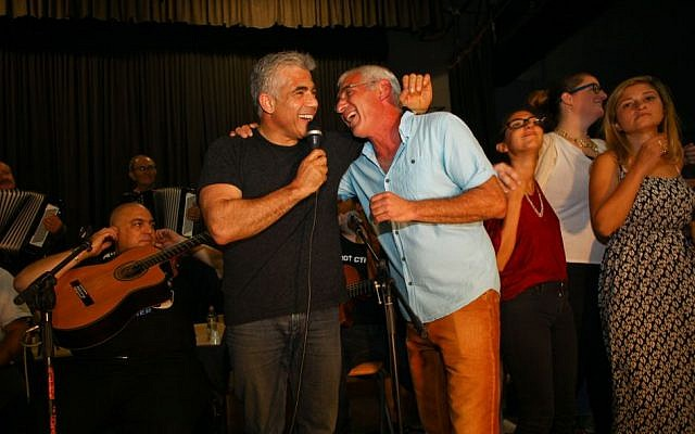 Yair Lapid, left, at a community singalong in southern Israel on Friday, September 12, 2014. (photo credit: Courtesy)