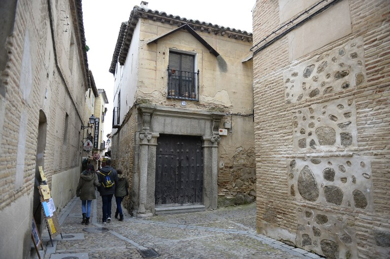 People walk in a street of the old Jewish Quarters of Toledo on February 27, 2014. (photo credit: AFP/Gerard Julien)