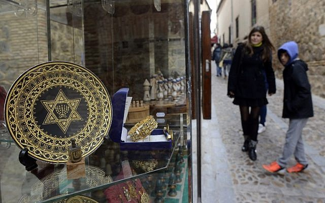 People stand near a gift shop in the old Jewish Quarters of Toledo, Spain on February 27, 2014. (photo credit: AFP/Gerard Julien)