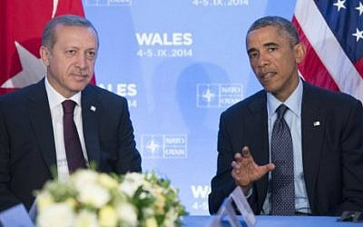 Barack Obama and Recep Tayyip Erdogan meet at a summit at the Celtic Manor Resort in Newport, South Wales on September 5, 2014. (photo credit: Saul Loeb/AFP)