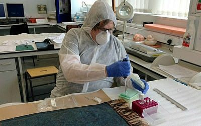 Dr. Jari Louhelainen conducts DNA testing on a shawl found next to one of Jack the Ripper's victims. (photo credit: Jari Louhelainen/AFP)