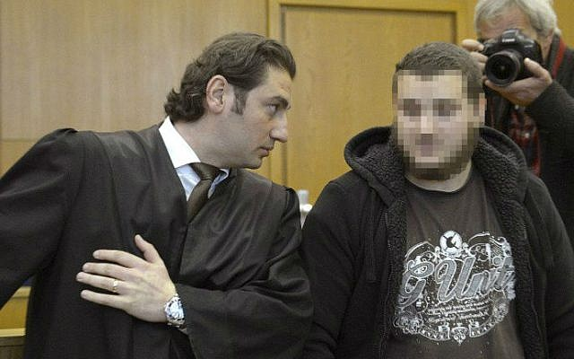 German alleged jihadist Kreshnik Berisha (right) listens to his lawyer Mutlu Guenal (left) as he arrives at the higher regional court in Frankfurt am Main, western Germany, on September 15, 2014 on the opening of his trial on charges of fighting for the Islamic State (IS) in Syria. (photo credit: AFP/Thomas Kienzle)