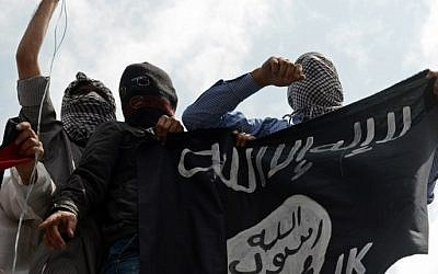 Illustrative photo of men holding up an Islamic State flag. (AFP/Tauseef Mustafa)
