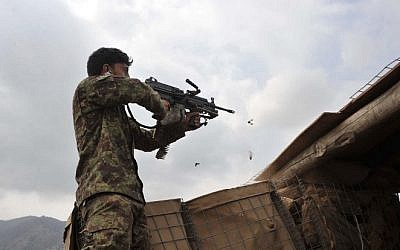 Afghan security personnel fire at Taliban insurgents during an anti-Taliban operation in Dur Baba district near the Pakistan-Afghanistan border in the eastern Nangarhar province on September 25, 2014 (Photo credit: Noorullah Shirzada/AFP)