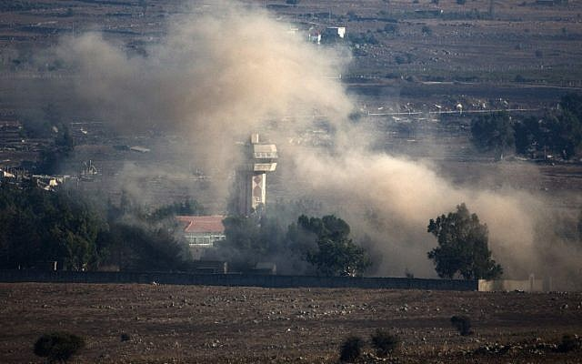 In a picture taken from the Golan Heights, smoke billows from the Syrian village of Quneitra following an explosion during fighting, between forces loyal to Syrian President Bashar Assad and rebels, near the Quneitra border crossing on August 31, 2014. (photo credit: AFP/MENAHEM KAHANA)