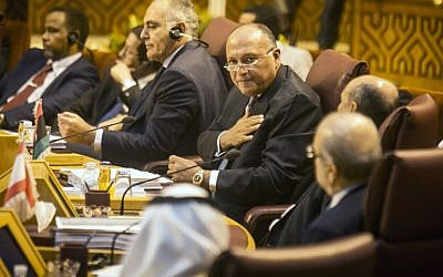 Egyptian Foreign Minister Sameh Shoukri (2R) gestures during a meeting of foreign ministers at the headquarters of the Arab League in the Egyptian capital Cairo on September 7, 2014. (photo credit: AFP/MOHAMED EL-SHAHED)