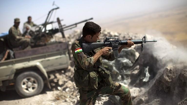 Illustrative photo of an Iraqi Kurdish peshmerga fighter firing at Islamic State (IS) positions, on September 9, 2014. (photo credit: AFP/JM Lopez)