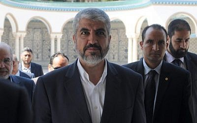 Hamas leader Khaled Mashaal arrives for a meeting with Tunisian president Moncef Marzouki at the Carthage presidential palace on the outskirts of Tunis on September 12, 2014. (Photo credit: AFP/ SALAH HABIBI)