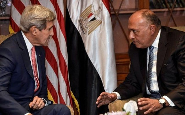 US Secretary of State John Kerry (left) meets with Egyptian Foreign Minister Sameh Shoukri on September 13, 2014 in Cairo. (AFP/ MOHAMED EL-SHAHED)