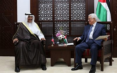 Palestinian Authority President Mahmoud Abbas, right, meets with Kuwaiti Foreign Minister Sheikh Sabah al-Khaled al-Sabah on September 14, 2014 in Ramallah. (photo credit: AFP/ABBAS MOMANI)