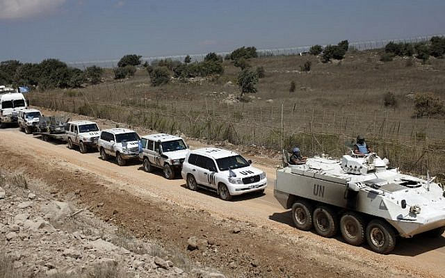A convoy of United Nations Disengagement Observer Force (UNDOF) vehicles as it leaves the Syrian side of the Golan Heights into Israel on September 15, 2014. (AFP/Jalaa Marey)