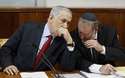Prime Minister Benjamin Netanyahu, left, listens to cabinet secretary Avichai Mendelblit during a special cabinet meeting in Jerusalem on September 23, 2014. (photo credit: AFP PHOTO/POOL/GALI TIBBON)