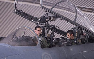 Saudi Arabian air force pilots sit in the cockpit of a fighter jet at an undisclosed location on September 23, 2014, after taking part in a mission to strike Islamic State targets in Syria (photo credit: AFP/Handout -- Saudi Press Agency)
