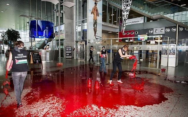 Women's rights movement Liliths' members, a Belgian former branch of the Femen, throw fake blood in the hallway of Liege airport to protest against Israel's military operation in Gaza, on August 26, 2014. (Photo credit: AFP / BELGA / NICOLAS LAMBERT)