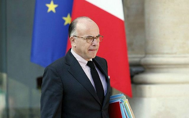 French Interior Minister Bernard Cazeneuve leaving a cabinet meeting at the presidential Elysee palace, Paris, on September 10, 2014. (photo credit: AFP/Patrick Kovarik)