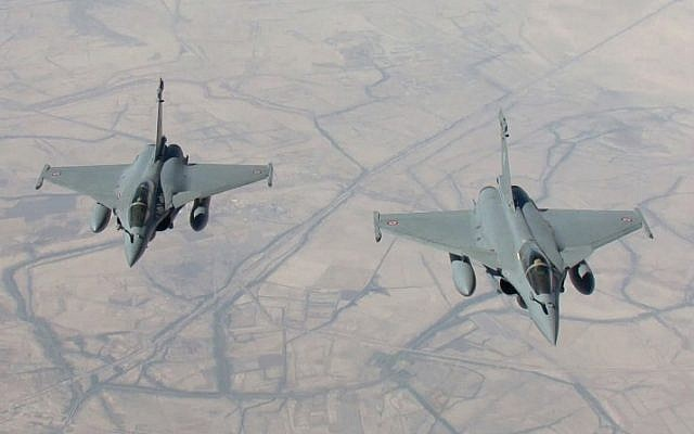 French Rafale fighter jets flying on a reconnaissance mission against the Islamic State over Iraq after taking off from the al-Dhafra base in the United Arab Emirates, September 15, 2014. (photo credit: AFP/ECPAD/EMA/Armee de L'air)