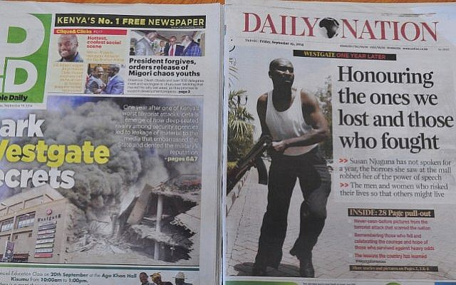 Kenyan newspapers with headlines related to the Westgate mall terror attack are pictured on September 19, 2014 as Kenya commemorates the first anniversary since the terror attack that happened in the Nairobi's shopping mall. (photo credit: AFP Photo/Simon Maina)