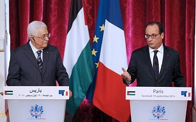 French President Francois Hollande (R) holds a press conference with Palestinian Authority President Mahmoud Abbas at the Elysee presidential palace in Paris on September 19, 2014. (photo credit: AFP/FRANCOIS GUILLOT)