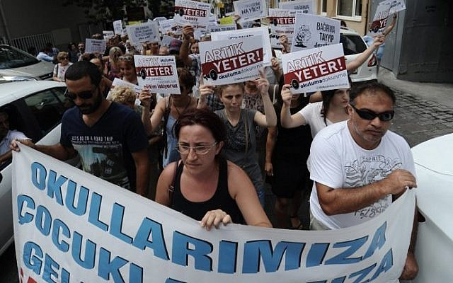 """Protesters march with placards reading """"enough! Don't turn our schools to Imam Hatips"""" on August 25, 2014 at Kadikoy in Istanbul. (photo credit: AFP Photo/Ozan Kose)"""