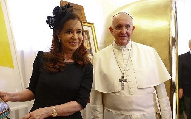 Pope Francis poses with Argentina's President Cristina Fernandez de Kirchner (L) during a private audience at the Vatican on September 20, 2014. (photo credit: AFP Photo/Pool/Tony Gentile)