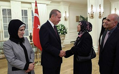 Turkish President Recep Tayyip Erdogan and his wife greeting some of the freed Turkish consulate hostages at the Cankaya presidential palace in Ankara, on September 21, 2014. (photo credit: AFP/Turkish Presidential Press Office/Kayhan Ozer)