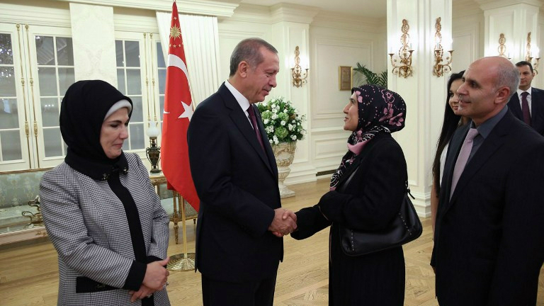 Turkey accused of prisoner swap with islamic state the times of israel turkish president recep tayyip erdogan and his wife greeting some of the freed turkish consulate hostages m4hsunfo