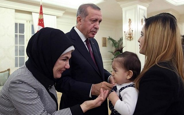 Turkish President Recep Tayyip Erdogan (2nd left) and his wife Emine (left) greeting some of the freed Turkish consulate hostages at the Cankaya presidential palace in Ankara, on September 21, 2014. (photo credit: AFP/Turkish Presidential Press Office/Kayhan Ozer)