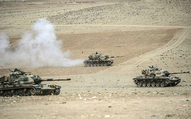 Turkish army tanks take up positions near the Syrian border on September 29, 2014. (photo credit: AFP/BULENT KILIC)