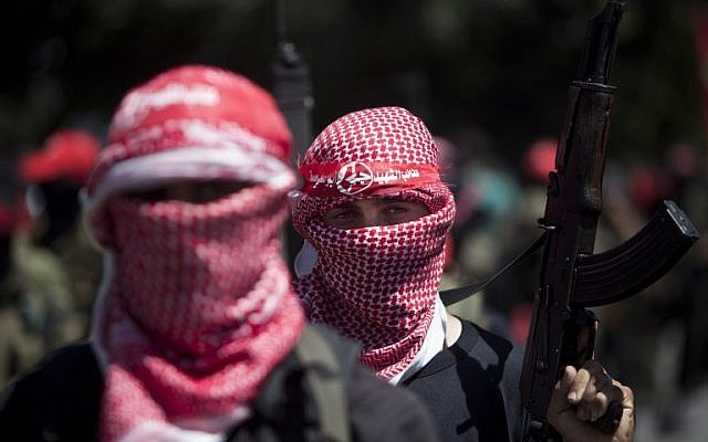 Masked Palestinian gunmen of the Popular Front for the Liberation of Palestine (PFLP) in Gaza City during a rally on September 2, 2014, to celebrate the Egypt-mediated ceasefire between Israel and Hamas. (photo credit: AFP/Mahmud Hams)