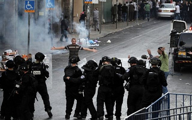 Illustrative photo of a Palestinian protester arguing with Israeli police during clashes in East Jerusalem (photo credit: AFP/ AHMAD GHARABLI)