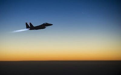 Illustrative photo of a US Air Force F-15E Strike Eagle flying over northern Iraq on September 23, 2014, after conducting airstrikes in Syria. (AFP/US Air Force/Senior Airman Matthew Bruch)