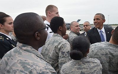 US President Barack Obama greets military personnel upon arrival at MacDill Air Force Base in Tampa, Florida, on September 16, 2014. (photo credit: AFP Photo/Mandel Ngan)