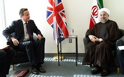 British Prime Minister David Cameron (L) meets with Iranian President Hassan Rouhani at the UN during the 69th Session of the UN General Assembly September 24, 2014 in New York. (photo credit: AFP/Timothy A. CLARY)