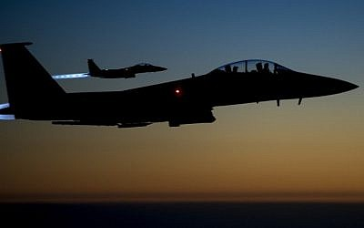 A pair of US Air Force F-15E Strike Eagles flying over northern Iraq early in the morning of September 23, 2014 after conducting airstrikes in Syria (Photo credit: AFP / US Air Forces Central Command via DVIDS / Senior Airman Matthew Bruch)