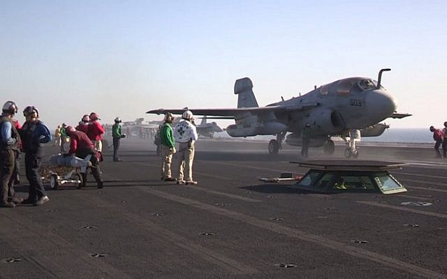 File: An EA-6B Prowler launching from the American aircraft carrier USS George H.W. Bush (CVN 77) supporting strike, surveillance and reconnaissance missions in Syria, September 26, 2014. (AFP Photo/Handout/US Navy)