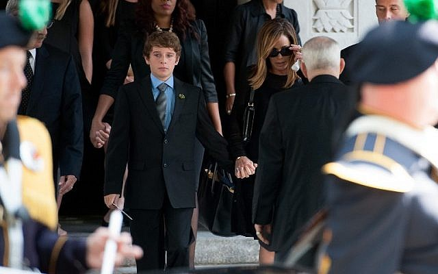 Melissa Rivers (center, right) and son Cooper Endicott (center, left) attend the Joan Rivers memorial service at Temple Emanu-El in New York City, September 7, 2014. (photo credit: D Dipasupil/Getty Images/AFP)
