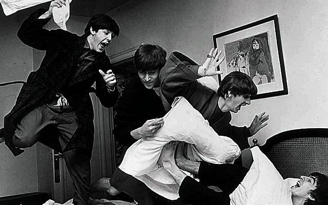 The Beatles -- from left, Paul McCartney, John Lennon, Ringo Starr and George Harrison -- letting off steam with a pillow fight. (photo credit: Harry Benson/JTA)