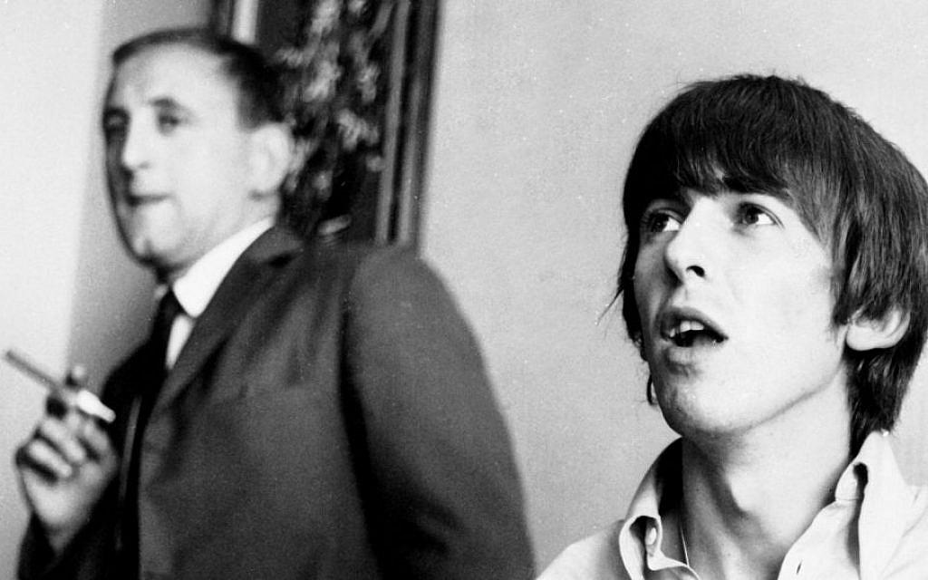 Author Ivor Davis, standing, doubled as ghostwriter for Beatle George Harrison. (Ron Joy-Belle Schwartz Estate/JTA)