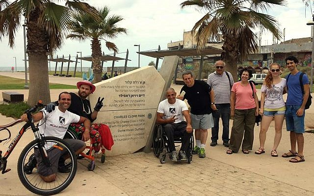 Gabriel Cordell (sixth from right) and supporters at Roll For Peace finish line at Charles Clore Park in Tel Aviv, September 29, 2014. (Courtesy of RollWithMe.org)