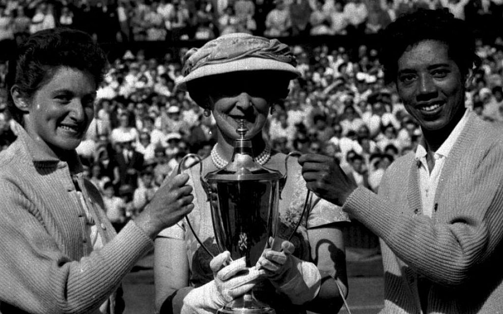 Duchess Marina of Kent presents Angela Buxton and Althea Gibson their trophy after their women's doubles win at the 1956 Wimbledon. (courtesy)