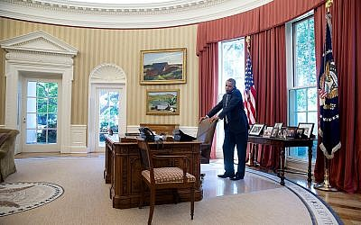 US President Barack Obama talks on the phone in the Oval Office, July 25, 2014. (photo credit: Pete Souza/ White House)