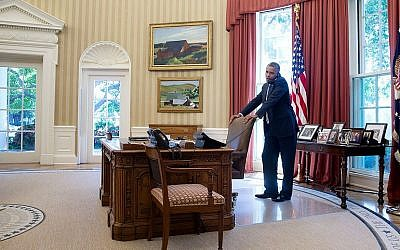 US President Barack Obama talks on the phone in the Oval Office, July 25, 2014. (photo credit: Pete Souza/White House)