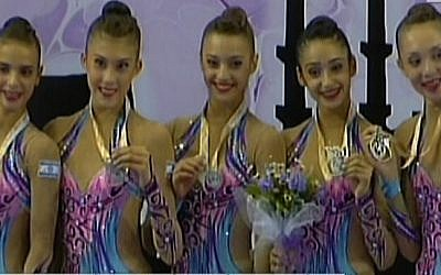 Members of Israel's rhythmic gymnastics teems show off their silver medals, Sunday, September 28, 2014 (screen capture: Channel 2)