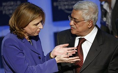 Then-foreign minister Tzipi Livni (left) with Mahmoud Abbas (right), president of the Palestinian Authority, at the World Economic Forum in Davos, Switzerland, September 2008 (photo credit: AP/Keystone/Alessandro della Valle)