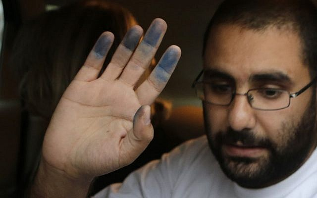 Egyptian activist Alaa Abdel Fattah upon his release from Tora prison in Cairo, September 15, 2014 (photo credit: AP/Amr Nabil)