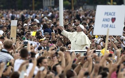 Pope Francis waves to faithful as he is driven through the crowd, in mother Teresa square, in Tirana, Sunday, September 21, 2014. (photo credit: AP Photo/Alessandra Tarantino)