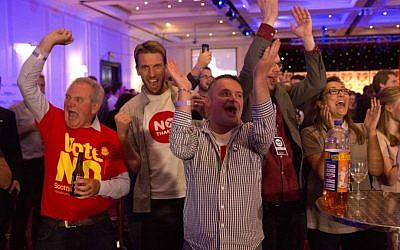 No supporters for the Scottish independence referendum celebrate an early result at a No campaign event at a hotel in Glasgow, Scotland, early Friday, Sept. 19, 2014. (AP Photo/Matt Dunham)